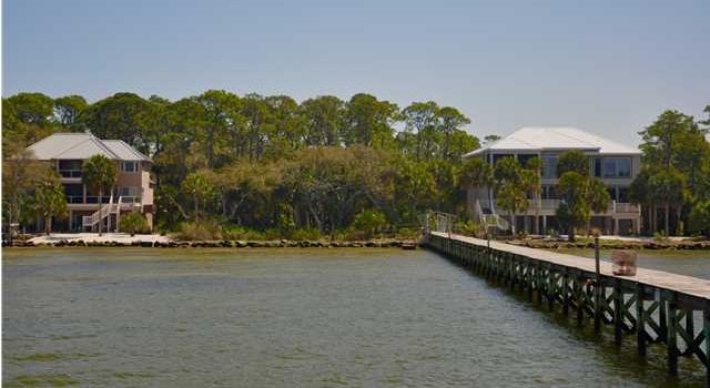 .88 acre Plantation bay front lot with shared boat dock