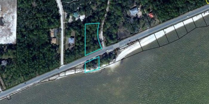1.25 acre bay view lot with 140' of bay frontage across Hwy 98
