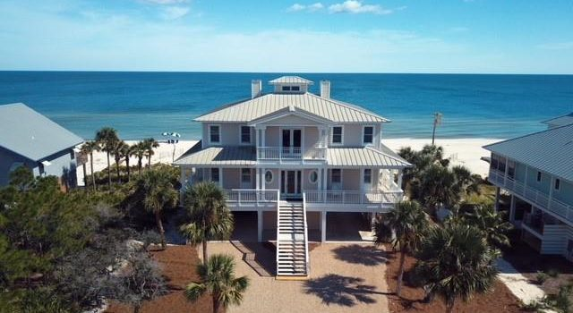 Plantation gulf front home with fireplace