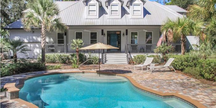 bay front home with private pool and boat dock located in Magnolia Bay subdivision