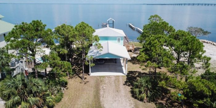 bay front home with private dock located in the Gulf Beaches