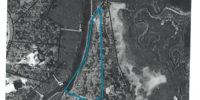 1 acre bay/canal front lot located in Sandpiper Village in the Plantation