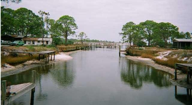 .26 acre canal front lot located on Dog Island